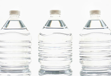 Canva - Three Clear Water Bottles